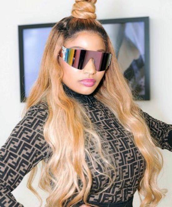 Nicki Minaj with Half Updo Hairstyle